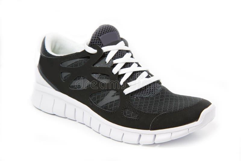Chaussure noire et blanche simple de sports photos libres de droits