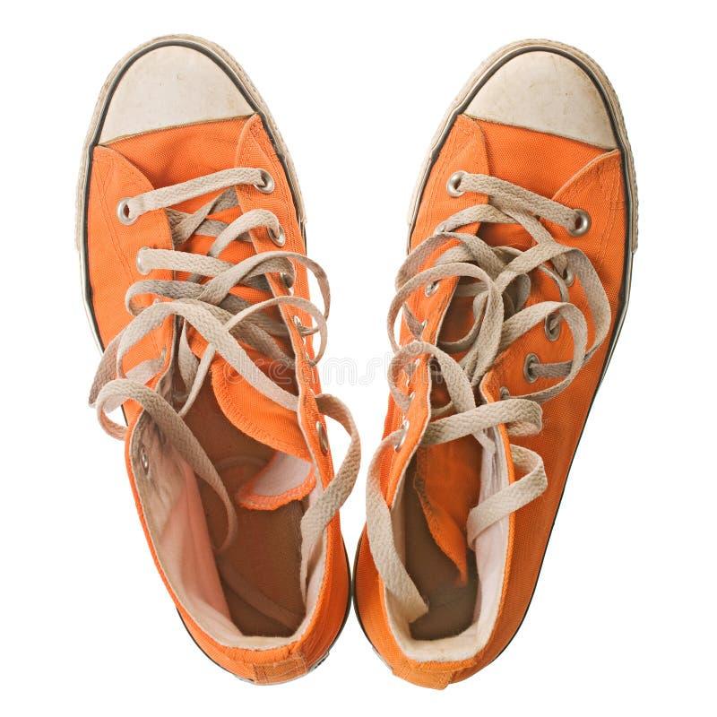 Chaussure orange, d'isolement sur le blanc image stock