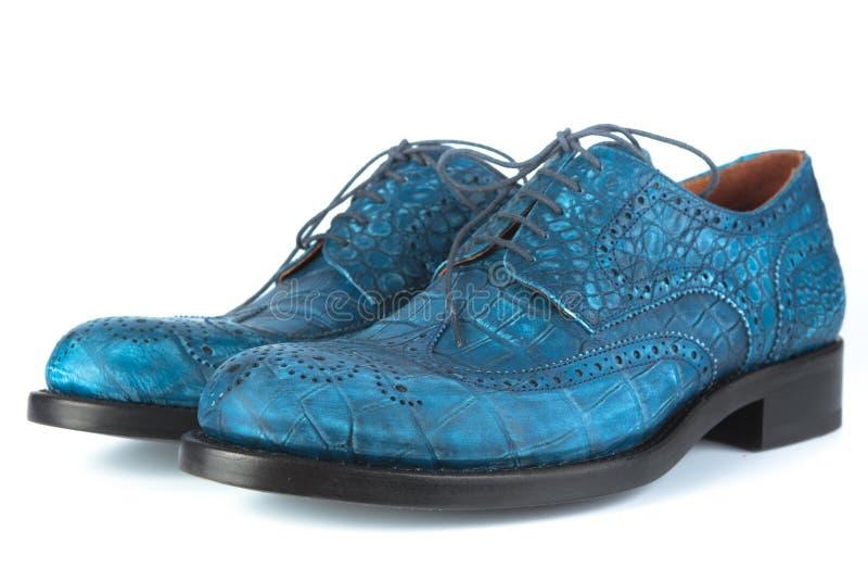 Chaussures bleues avec des lacets photographie stock libre de droits