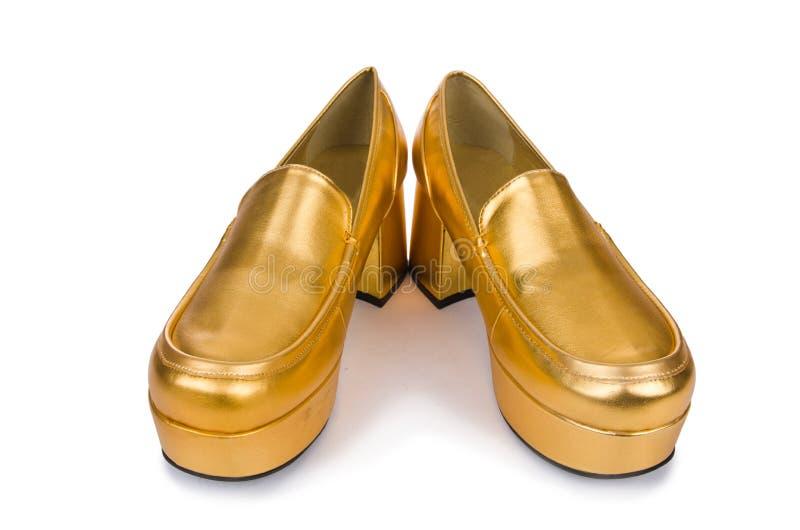 Chaussures d'or de femme d'isolement photographie stock libre de droits