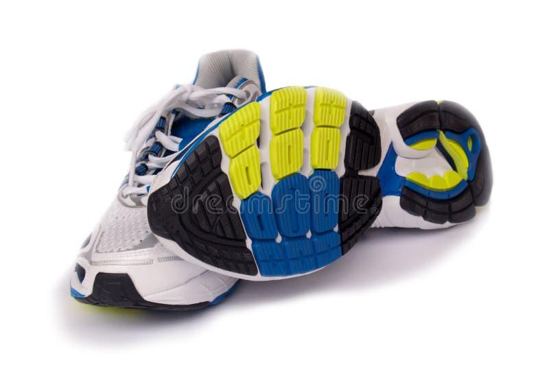 Chaussures de course de sport d'isolement sur le fond blanc photos libres de droits