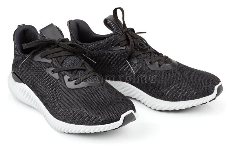 Chaussures de course, espadrilles ou entraîneurs d'isolement sur le blanc photo libre de droits