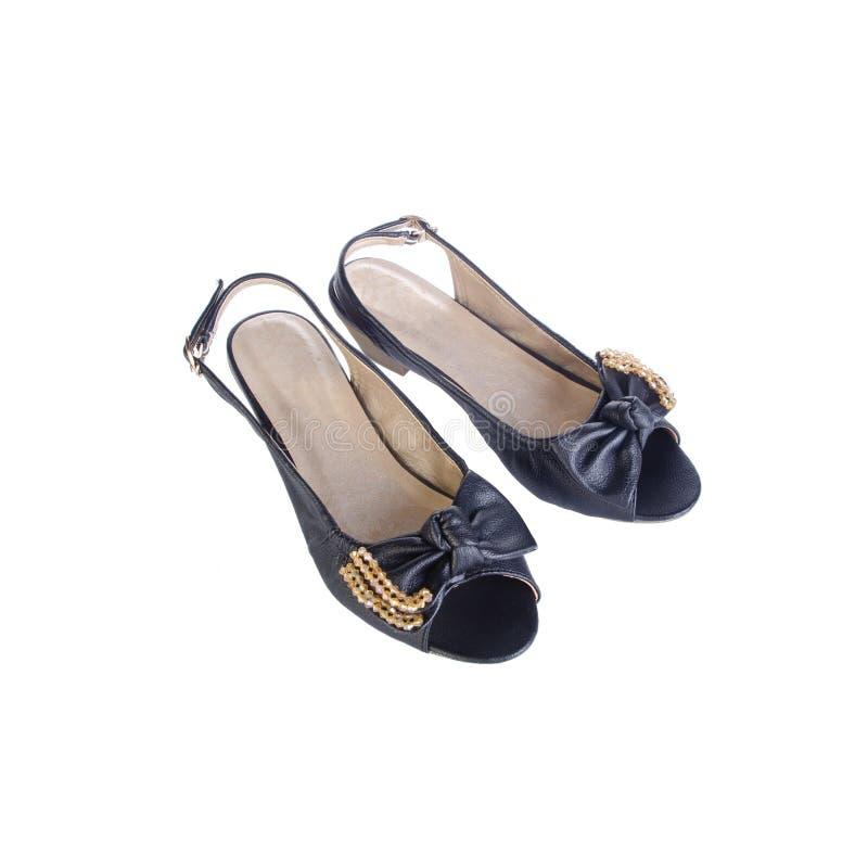 Chaussures, chaussures de dames sur le fond photo libre de droits