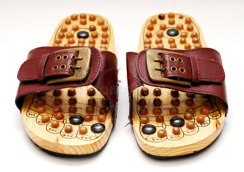 Chaussures de reflexology de pied photos stock