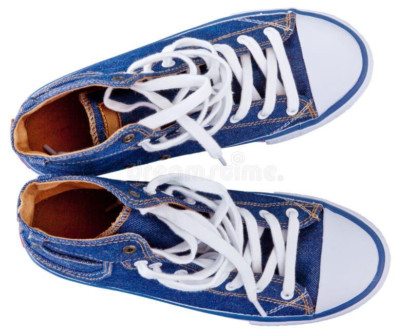 Chaussures en caoutchouc, chaussures de tennis photos libres de droits