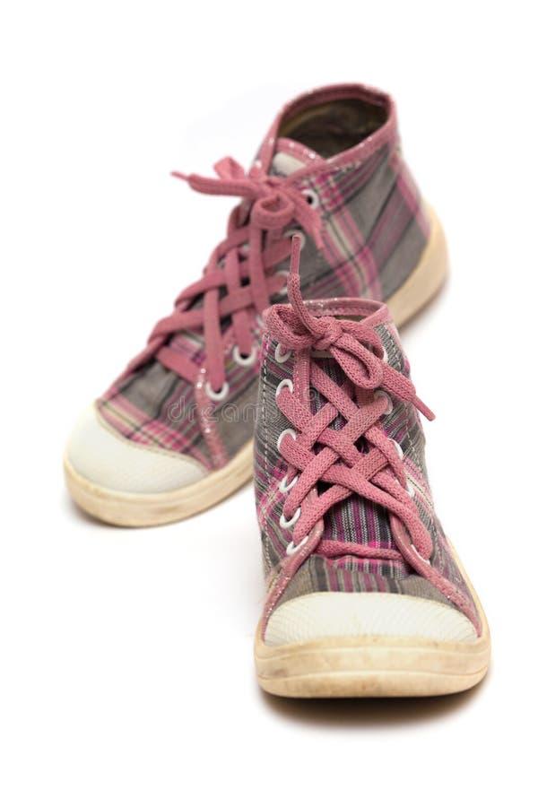 Chaussures en caoutchouc roses de tartan images stock