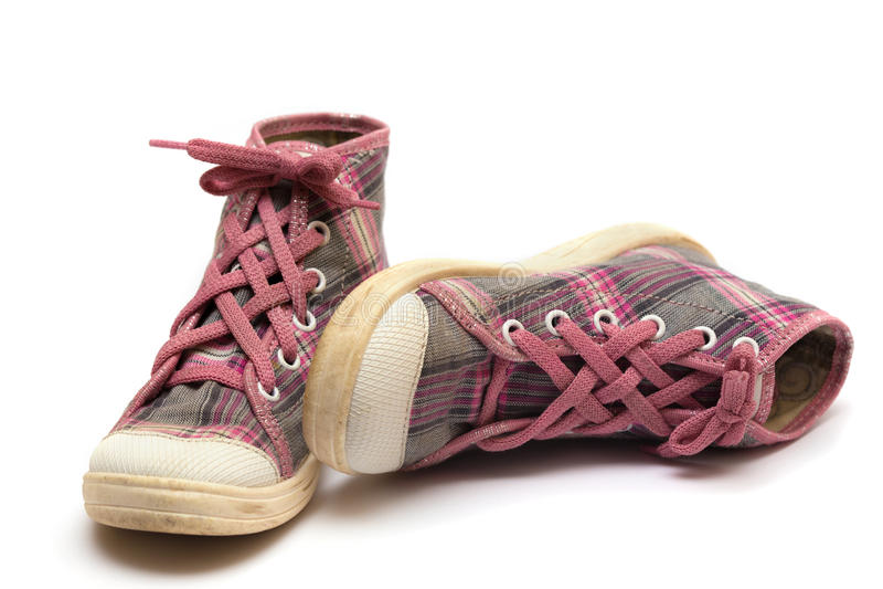 Chaussures en caoutchouc roses de tartan images libres de droits