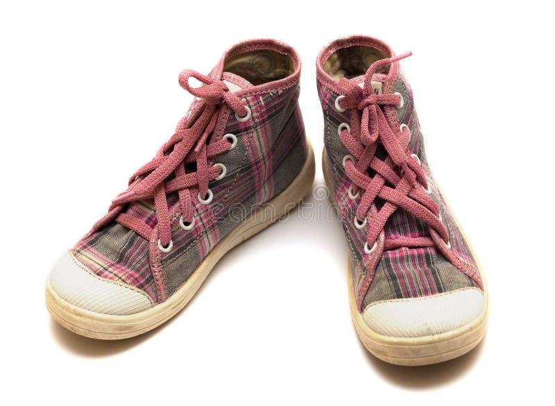 Chaussures en caoutchouc roses de tartan photo libre de droits