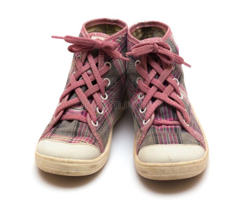 Chaussures en caoutchouc roses de tartan image stock