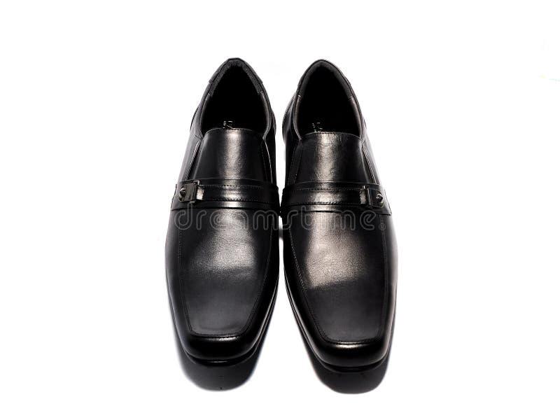 Chaussures en cuir d'isolement sur le fond blanc photo stock