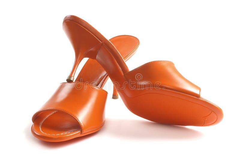 Chaussures en cuir femelles rouges photo stock