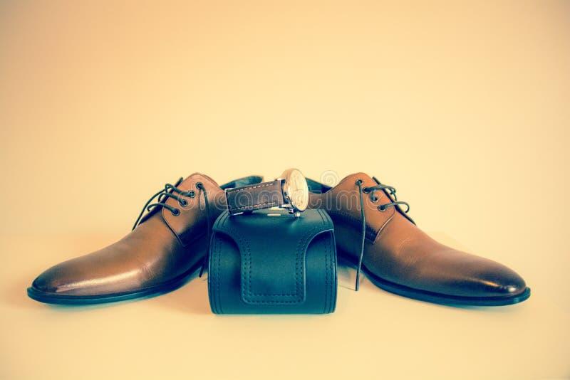 Chaussures et montre photographie stock