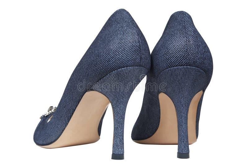Chaussures femelles de jeans image stock
