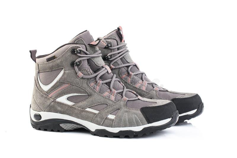 Chaussures femelles grises d'isolement sur le fond blanc image stock