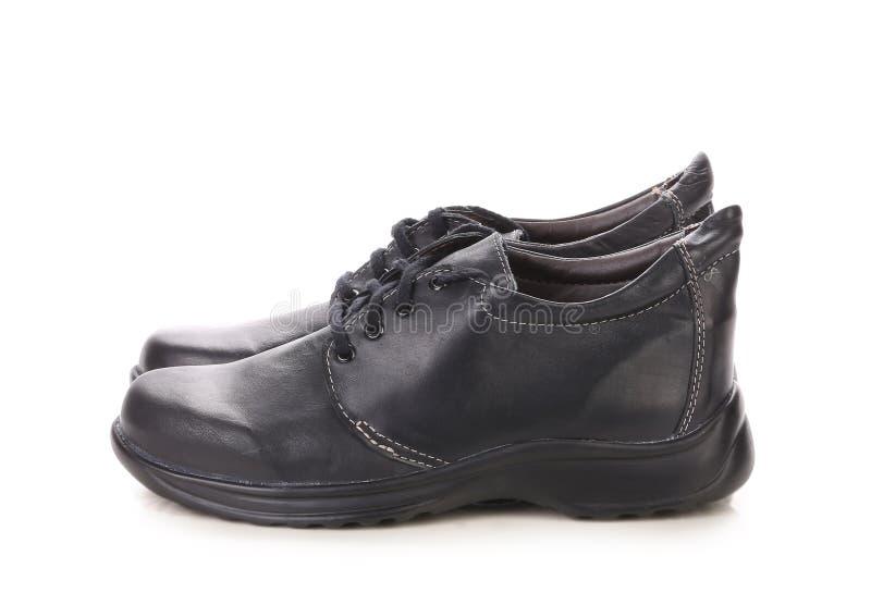 Chaussures noires confortables photographie stock libre de droits