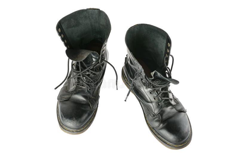 Chaussures noires d'armée d'isolement sur le fond blanc image libre de droits
