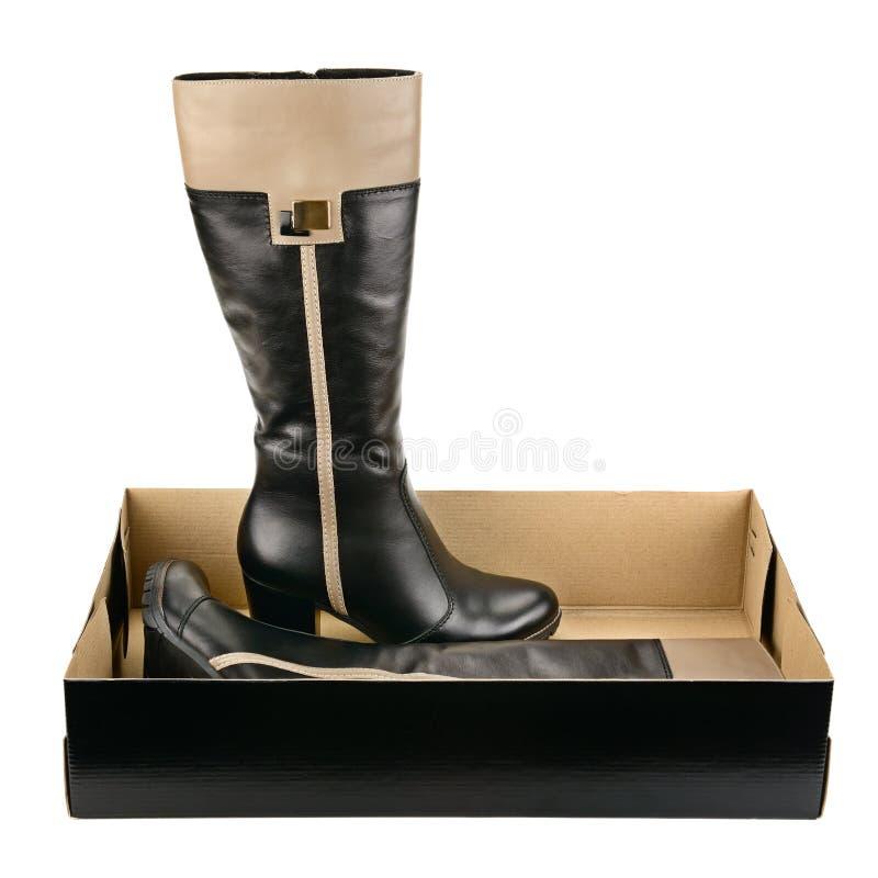 Chaussures noires d'isolement sur le blanc photos libres de droits