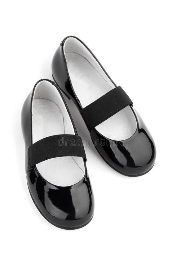 Chaussures noires de fille de cuir d'éclat image libre de droits