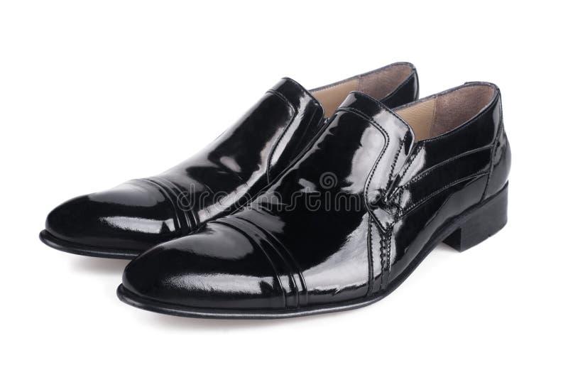 Chaussures noires polies de mens images stock