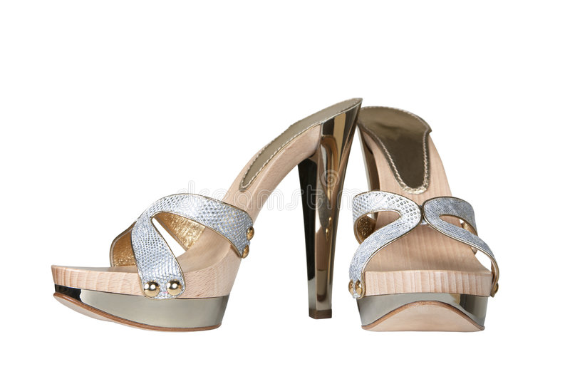 Chaussures sur une plate-forme en métal photographie stock