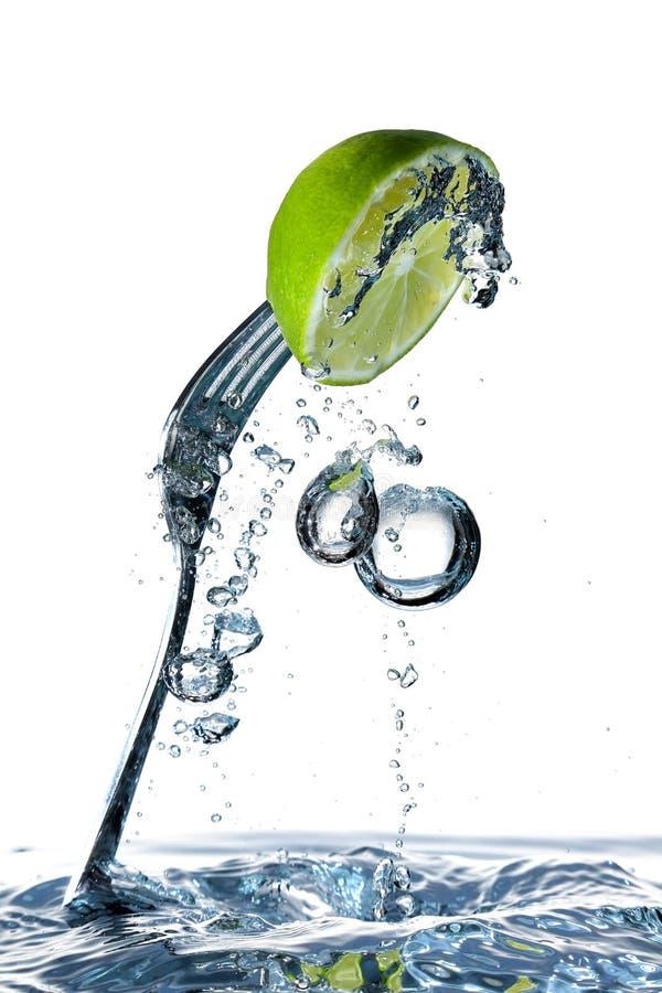 Chaux et fourchette image stock