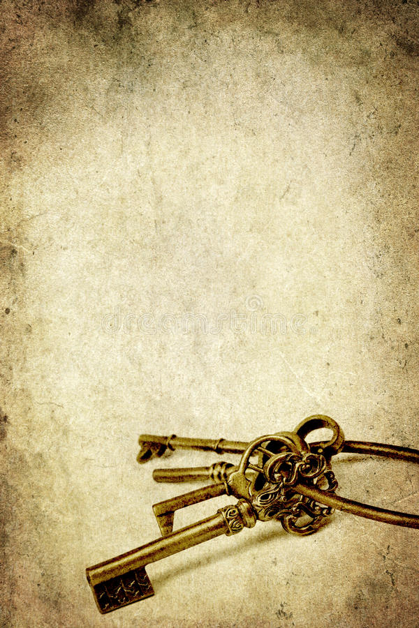 Chave de bronze velha isolada no branco foto de stock