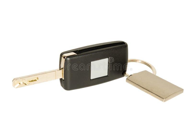 Chave do carro com o keychain e a placa de identificação isolados no branco fotografia de stock royalty free