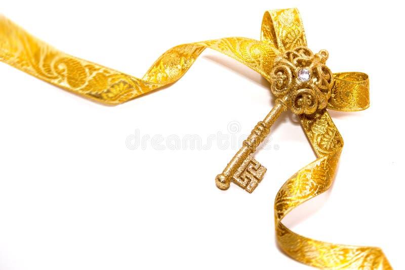 Chave dourada do Natal imagem de stock royalty free