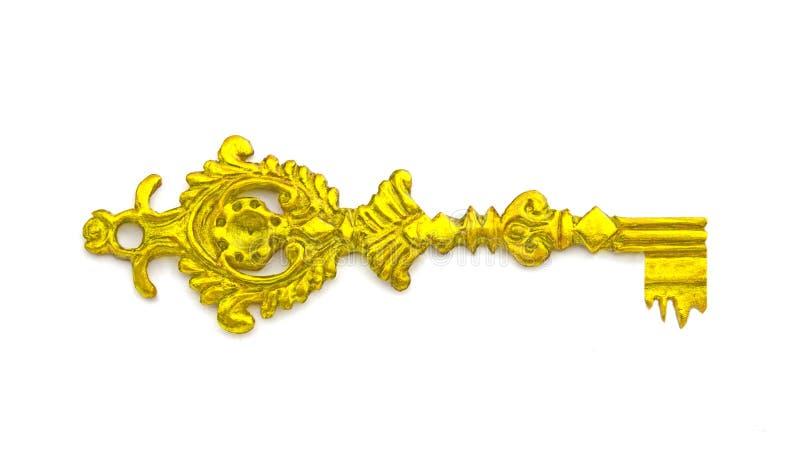 Chave dourada medieval antiga no fundo branco imagens de stock royalty free