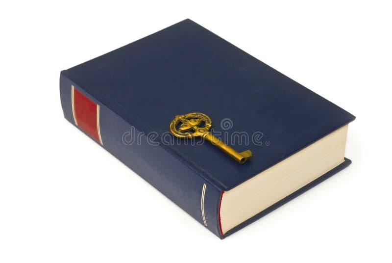Chave no livro fotos de stock