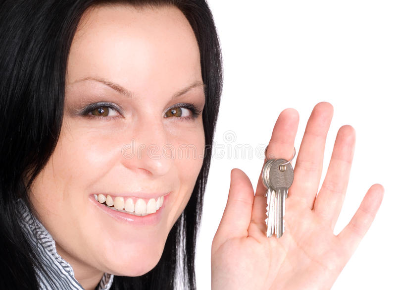 Chaves da terra arrendada da mulher sobre o branco imagens de stock royalty free
