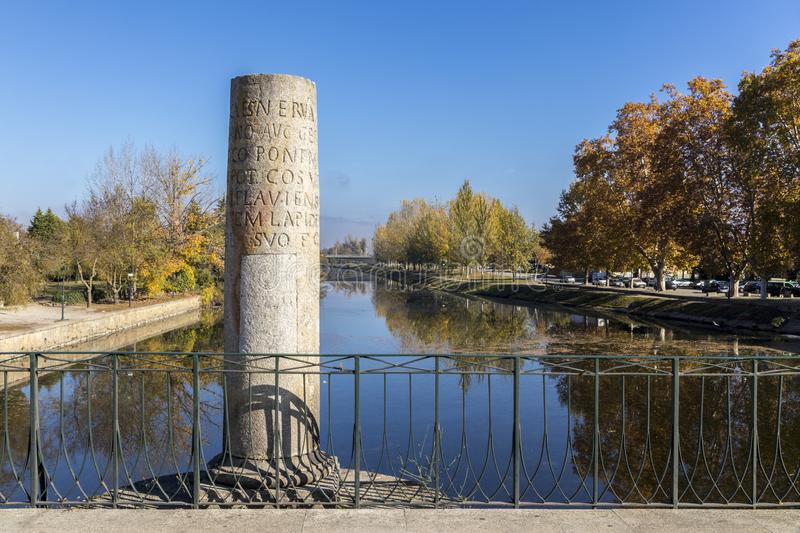 Chaves, Portugal. One of the commemorative marker columns of the historic Roman bridge of Emperor Trajan in the city of Chaves, in the north of Portugal stock image