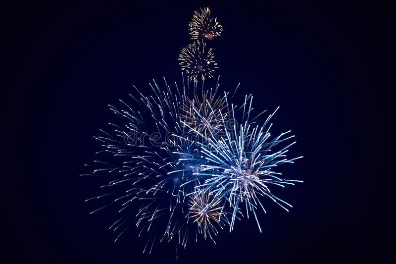 Cheap beautiful sparkling fireworks, blue, night sky, background texture stock image