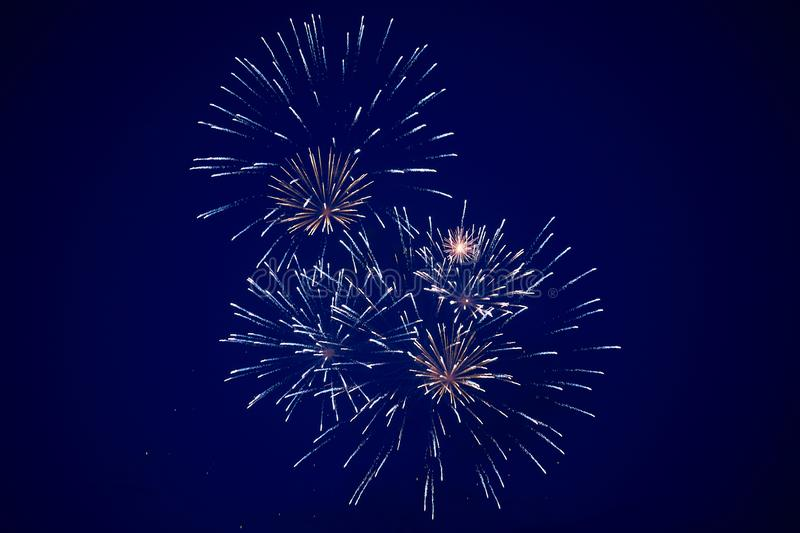 Cheap bright sparkling fireworks, blue and golden color, on the night sky, background texture royalty free stock photos