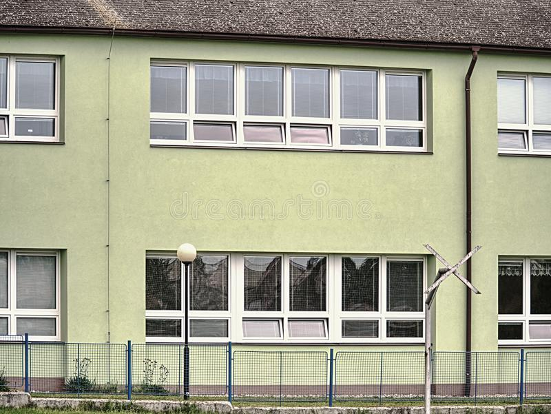 Cheap flats windows in  etage house in small town. Low cost royalty free stock photo