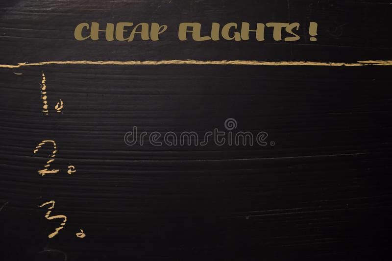 Cheap Flight! written with color chalk. Supported by an additional services. Blackboard concept stock photo