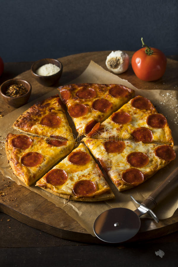 Cheap Greasy Frozen Pepperoni Pizza. Ready to Eat stock photo