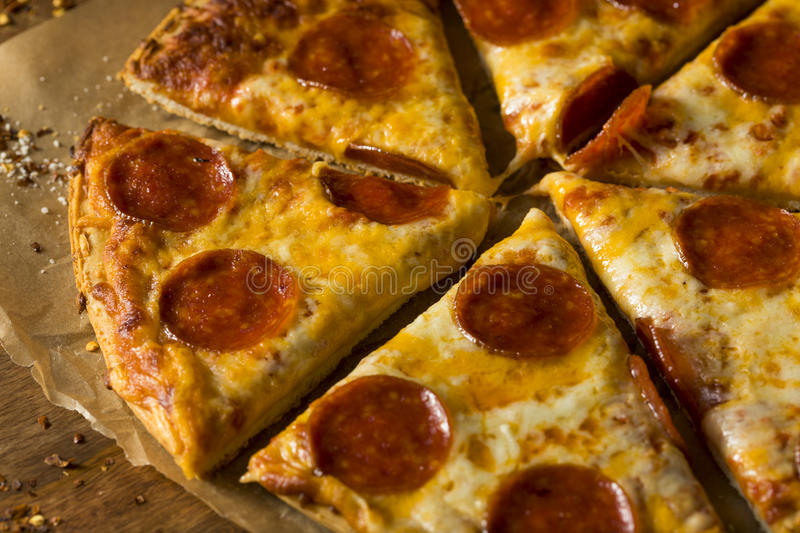 Cheap Greasy Frozen Pepperoni Pizza stock image