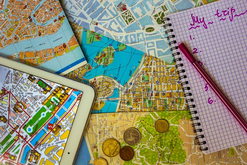 on the tablet is a map of paris small coins of european countries notepad with the inscription my trip view from above