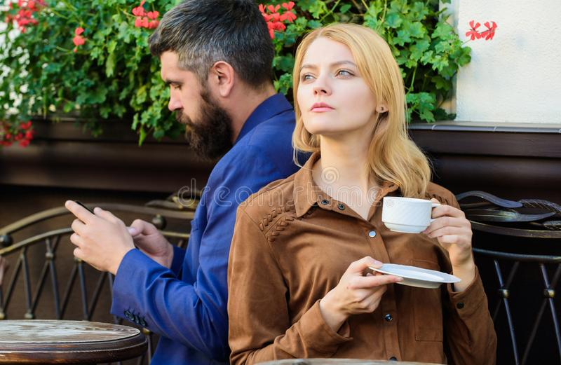 Cheat and betrayal. Family weekend. Married lovely couple relaxing together. Couple cafe terrace drink coffee. Couple in. Love sit cafe terrace enjoy coffee royalty free stock images