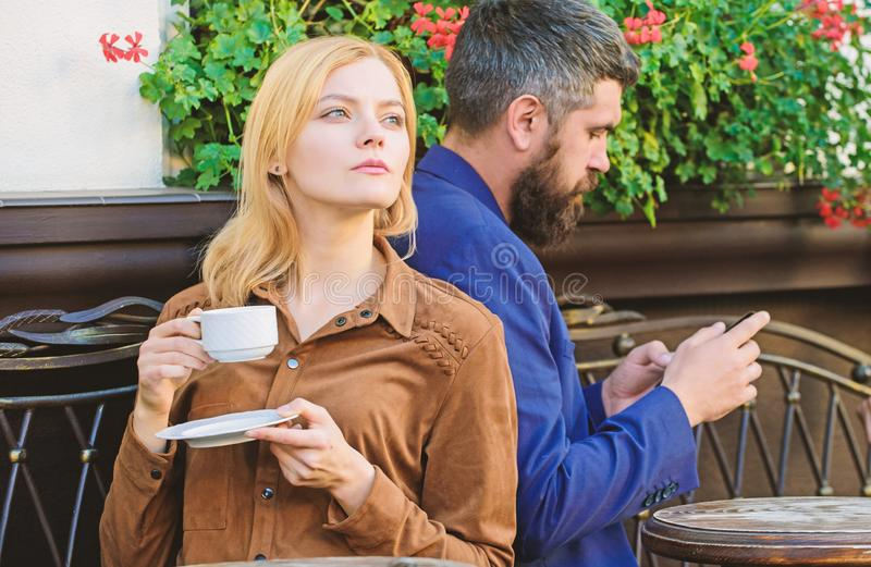 Cheat and betrayal. Family weekend. Married lovely couple relaxing together. Couple cafe terrace drink coffee. Couple in. Love sit cafe terrace enjoy coffee stock image