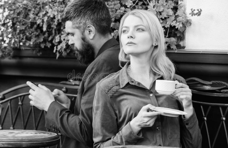 Cheat and betrayal. Family weekend. Married lovely couple relaxing together. Couple cafe terrace drink coffee. Couple in. Love sit cafe terrace enjoy coffee stock photography