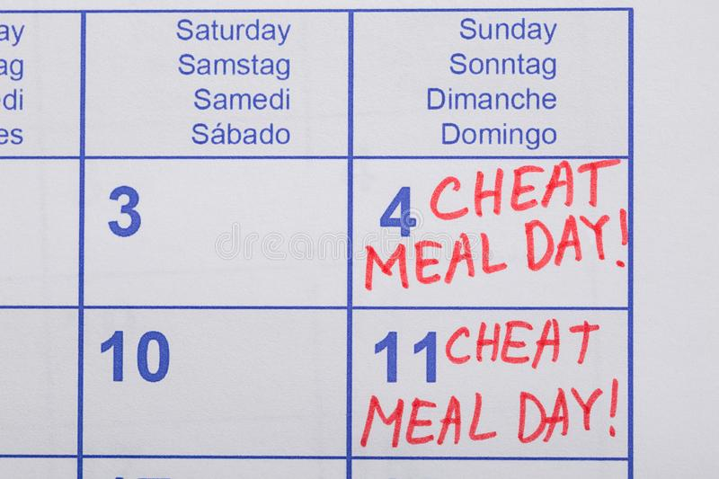 Cheat Meal Day Text Written On Calendar royalty free stock image