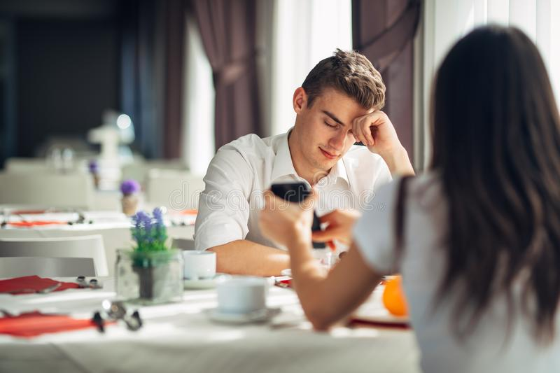Cheating man caught having an affair.Man accused and attacked,guilty man being unfaithful.Relationship problems,divorce,break up. Cheating men caught having an stock images