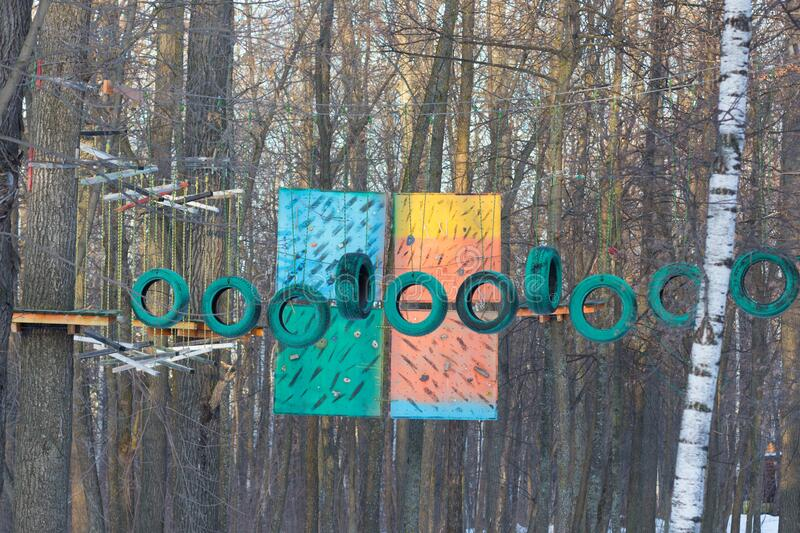 Cheboksary Russia - 10 December 2019: Rope park in the Lakrevskiy forest with green tires. Cheboksary Russia - 10 December 2019: Rope park in Lakrevskiy forest royalty free stock photography