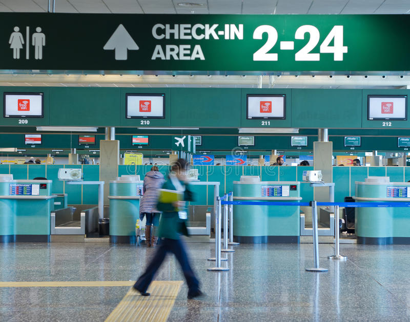 Check-in area in the airport stock images