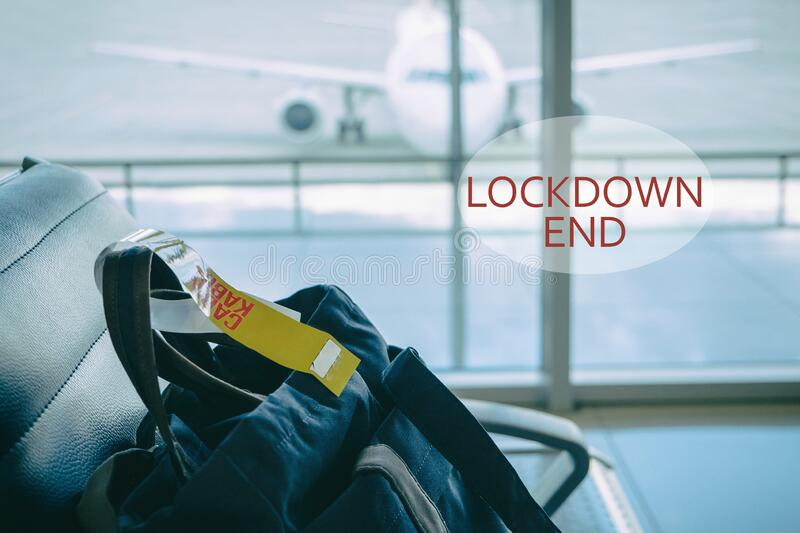 Check-in baggage on the chair in waiting lounge of airport royalty free stock image