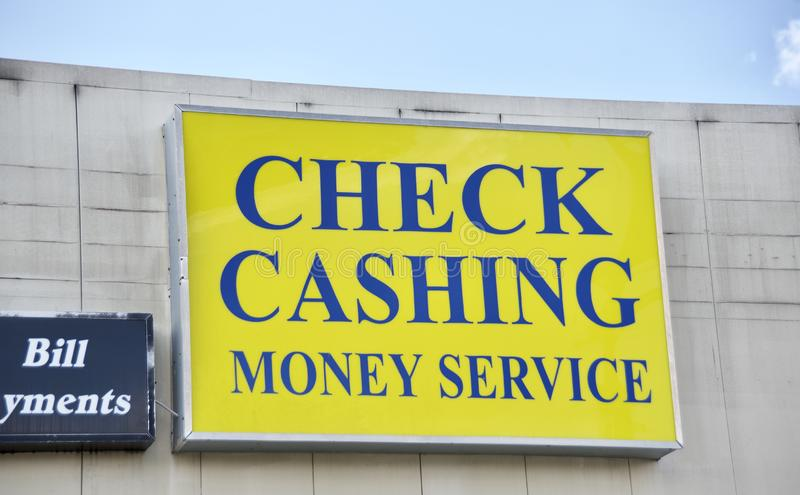 Check Cashing and Money Services. A check cashing, money service and bill payment center caters to people without a checking or bank account, this business royalty free stock photo