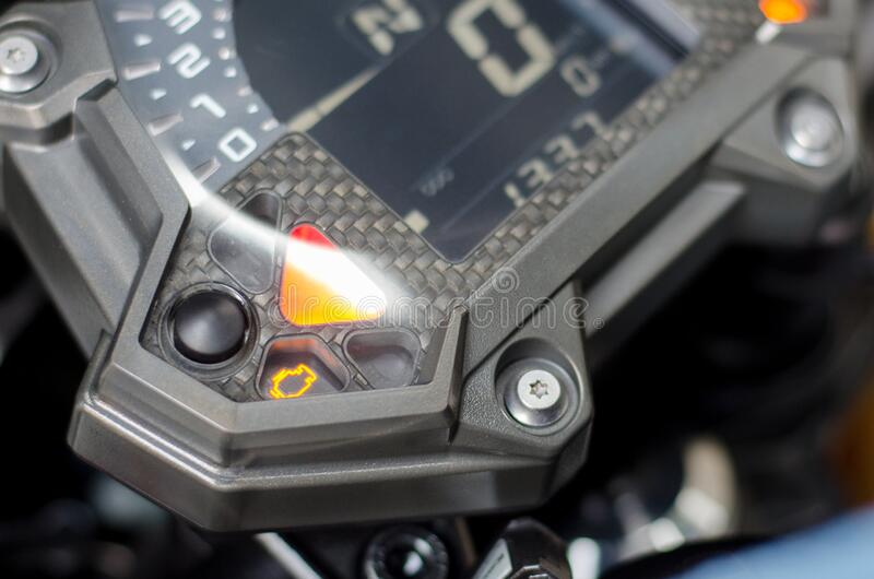 Check engine malfunction light on motorcycle dashboard stock photo