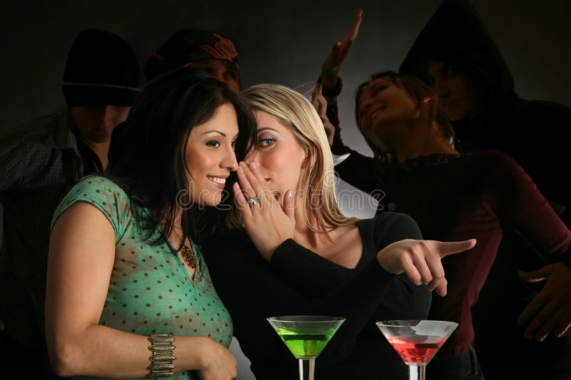 Check him out!. Girlfriends gossiping about guys in the party